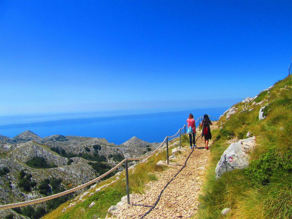 Girls walking on Biokovo mountain