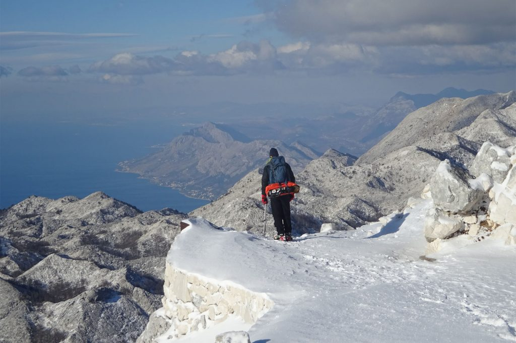 Hiker on Biokovo mountian on snowy weather